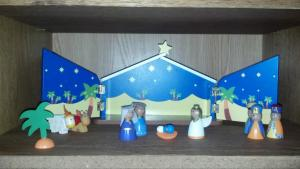 This is Max's new nativity scene. We've already had to glue Mary and Joseph's head coverings back on.