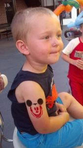 max's mickey tattoo